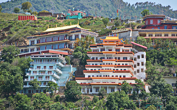 Photo: A grandiose view of the entire seven floors high Sowa Rigpa Medical Institute. Light blue building to its left side is the Guest House of Menri Monastery. se