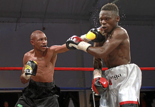 Thato Bonokwane, left,  will face  Samuel Esau from Western Cape in an eight-rounder in Kagiso on Saturday. Bonokwane is seen here pummeling  Bongani Bhuti in a previous bout.