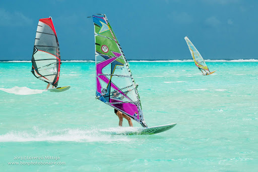 bonaire-windsurfers.jpg - Windsurfers catch the breeze in a bay on Bonaire.