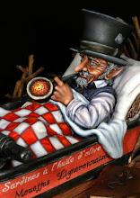 """Photo: """"Gnôme à l'huile"""" sculpture Stéphane Guerry, peinture Gilles Paternostre. D'après un dessin de Jean-baptiste Monge (extrait de """"A la recherche de féérie"""" Editions: Au bord des Continents)"""