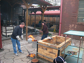Photo: Mike stirring the fire to reduce his pot's surfaces.