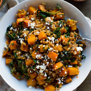 Roasted Butternut Squash Winter Salad with Kale, Farro and Cranberry Dressing.