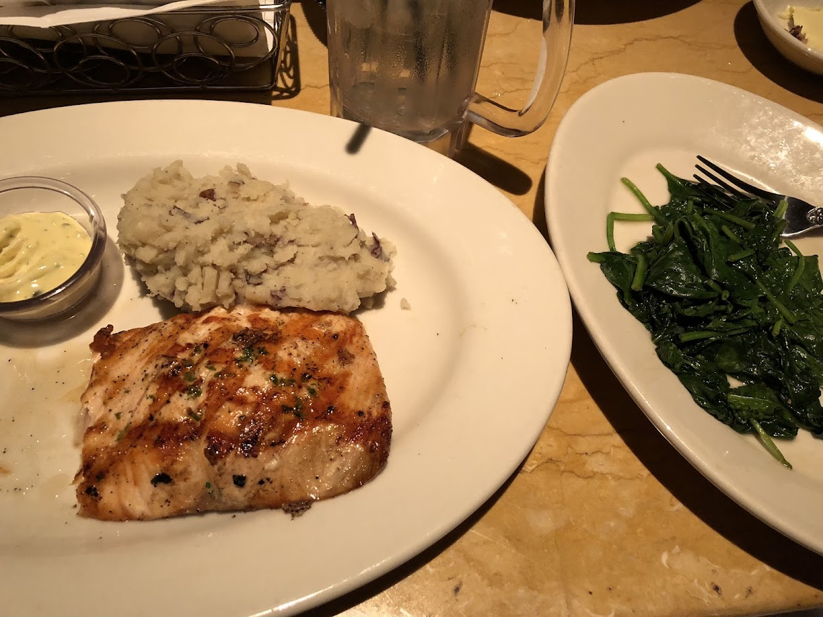 Grilled salmon with mashed potatoes and sautéed spinach