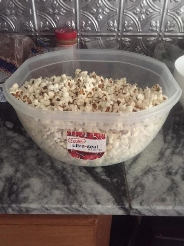 Add the remaining cup of popcorn. Cover and randomly shake the pot to keep...