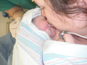 Photo: Baby's first kiss