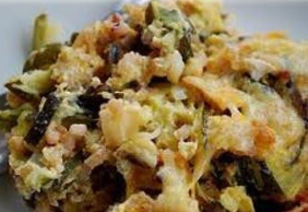 Add zucchini, rice, cottage cheese, soup and salt.Mix wellSprinkle cheddar and parmesan cheeses over...