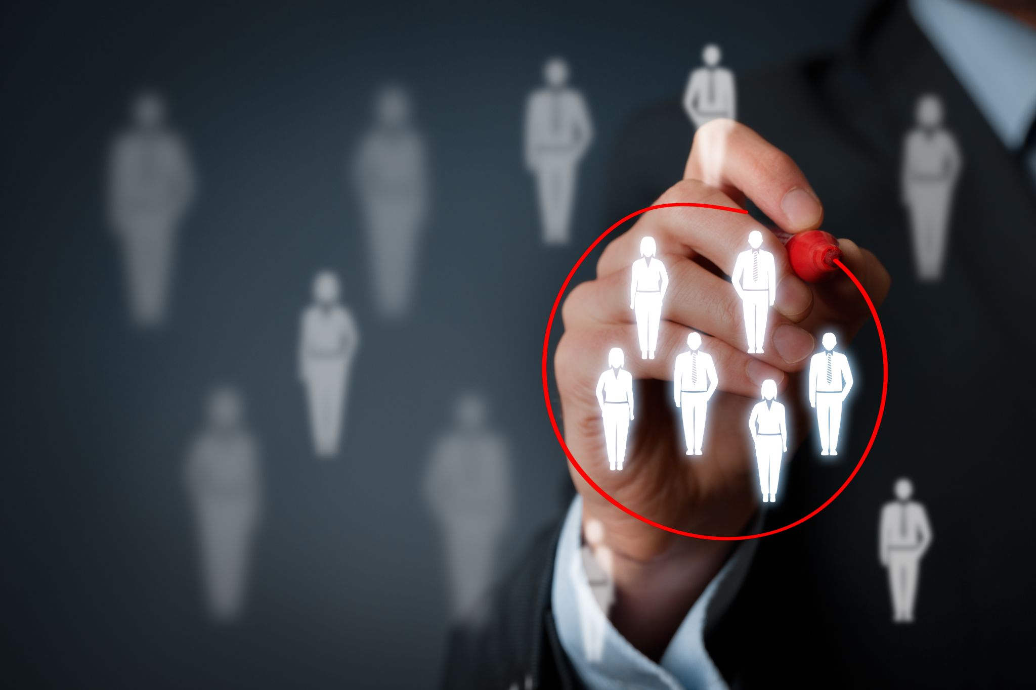 Business man segmenting a group of people by drawing a red circle around them using the STP marketing model