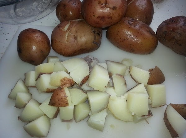 To Prepare Red Skinned Jerk Potato Salad:  Clean potatoes, place in large stock pot with...