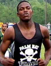 Xavier Carter finishes up his 400 meter victory at Mobile in 2003. Photo by John Dye.