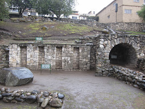 Photo: Pre-incan wall with niches, and colonial arch