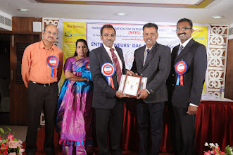 Photo: Prof. Dr. R. Ganesan, Chairman, NFED Issuing the Best Entrepreneur Award to  Mr. G. T. Pannerselvam, Proprietor, G K Thavasiappan Sons, Gobichettipalaya, Erode