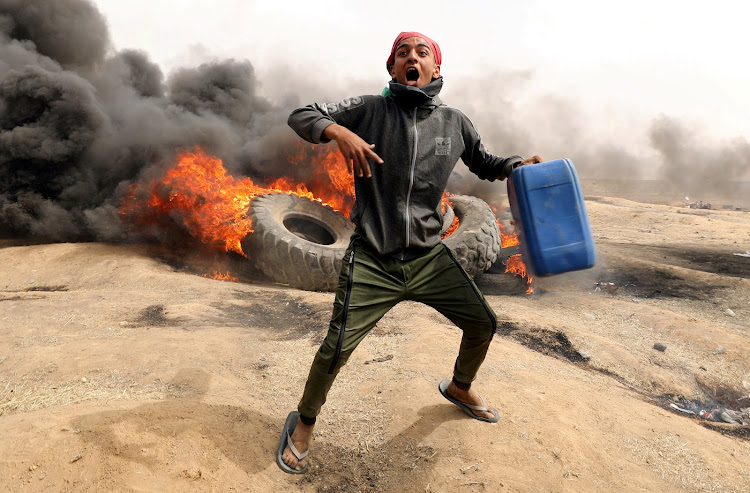 A Palestinian demonstrator during clashes with Israeli troops at a protest on the Israel-Gaza border where Palestinians demand the right to return to their homeland.