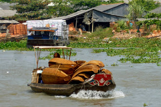 Photo: There is a lot of transportation on the river.  This person is bringing small boats to town to sell.