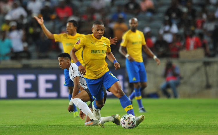 Vincent Pule of Orlando Pirates challenges Andile Jali of Mamelodi Sundowns during Absa Premiership match between Orlando Pirates and Mamelodi Sundowns on 15 January 2020 at Orlando Stadium.
