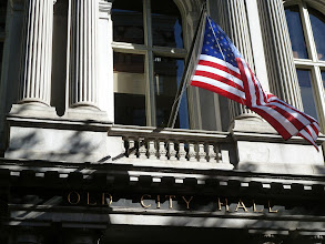 Photo: Stars and Stripes above the entrance of the Old City Hall which now is home to a Steak House.