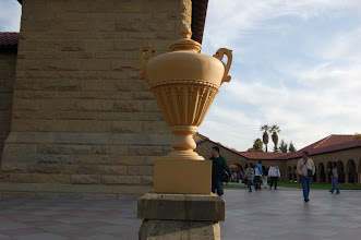 Photo: Requirement 5 (poor composition): I centered the urn sculpture, and the centering oddly split the photo almost exactly in half, making the scene look disjointed (and maybe even pasted together). The photo isn't really zoomed in enough, and the background and vertical split is distracting.