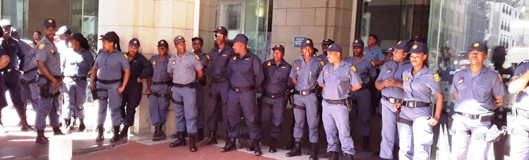 Police guard the entrance to the Western Cape legislature in Cape Town on February 15 2019. Calls by ANC acting provincial chair Khaya Magaxa, provincial head of elections Ebrahim Rasool and provincial secretary Faiez Jacobs on residents from across Cape Town to occupy Wale Street appeared to have fallen on deaf ears.