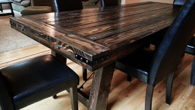 """Photo: Viking Dining Table 96""""L x 41""""W x 30""""H Color: Black Walnut Finish: Dull Rubbed Hardware: Corner Brackets, Wire and Turnbuckle, End Bolts Investment: 1600"""