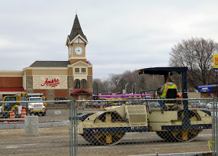 Photo: Tamping down the gravel for the parking lot.