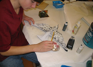 Photo: Student working on Papier Mache project:  a Falcon.