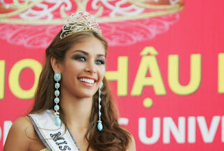 Photo: NHA TRANG, VIET NAM - JULY 14:  Dayana Mendoza of Venezula, the newly-crowned Miss Universe 2008, poses for photographs following the winner announcement of the 57th Annual Miss Universe Competition at the Diamond Bay Resort & Golf on July 14, 2008 in Nha Trang, Vietnam. Miss Dayana Mendoza of Venezula beat 80 other contestants in three categories of swimsuit, evening gown and interview to win the coveted title of Miss Universe 2008.  (Photo by Gaye Gerard/Getty Images) *** Local Caption *** Dayana Mendoza