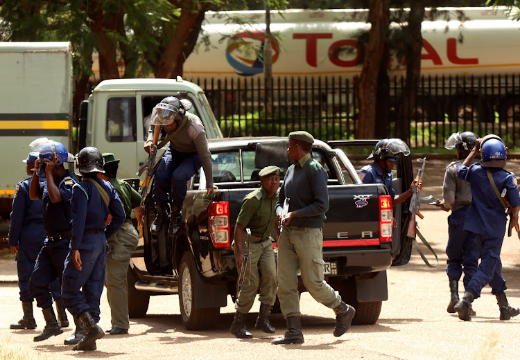 Police stand guard as people are arrested in Harare, Zimbabwe, in a file photo dated January 18 2019.