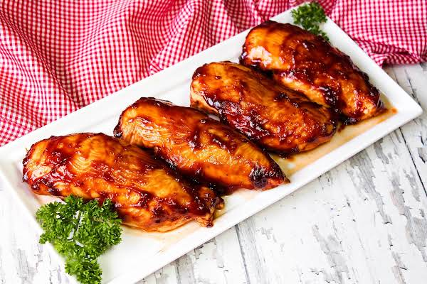 A Platter Of Barbecue Chicken Breasts.