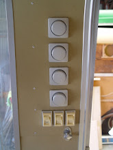 Photo: lighting system panel by the front door. rivets will be painted out. 4 - 12 volt dimmers for the 4 lighting zones and switches for the exterior lights