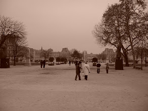 Photo: In the Tuileries, with the Louvre in the background.