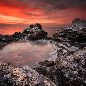 Fire and ice by Evgeni Ivanov - Landscapes Sunsets & Sunrises ( smooth, tranquil scene, stone, rock, beauty, boulder, beach, coastline, landscape, sun, sky, nature, flowing water, idyllic, dark, long exposure, evening, water, wild, orange, reef, cliff, cloudscape, sea, seascape, sunlight, morning, dawn, sunset, background, moody sky, rocky coastline, cloud, sunrise,  )