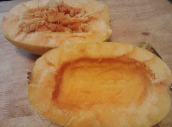 Cut spaghetti squash in half and clean and discard seeds. Place on baking sheet, drizzle...