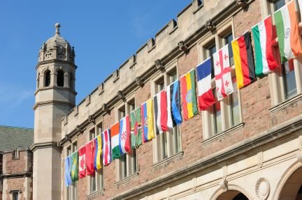 Photo: The flags of more than sixty countries from around the globe line the entire east facade of Ridgley Hall and smaller portions of January and Dunker Halls. Each flag represents the home country of a student graduating at Commencement on Friday, May 18, 2012.
