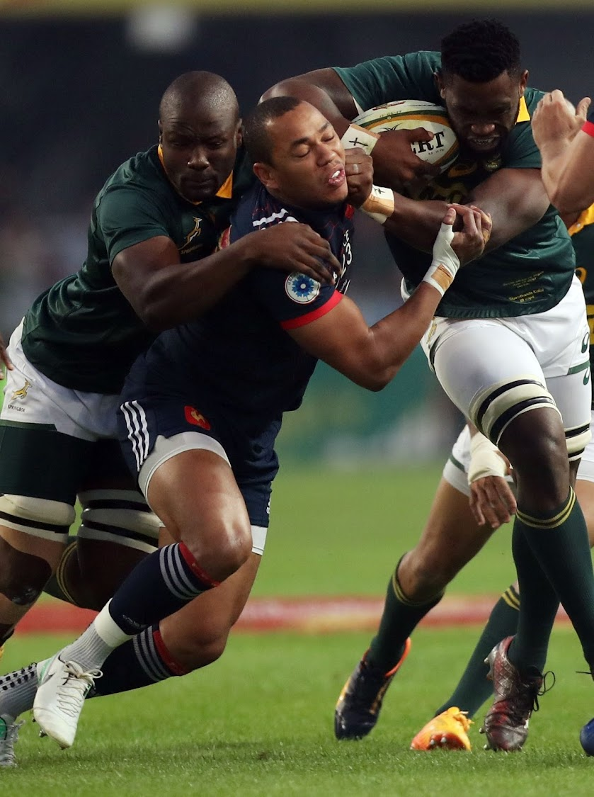 Gael Fickou of France looks to tackle Siya Kolisi of South Africa during the Test match at Growthpoint Kings Park in Durban on Saturday. Picture: GALLO IMAGES