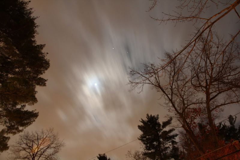 Photo: A ten second exposure with moving clouds and the moon. Jupiter and Aldebaran can also be seen through a break in the clouds.