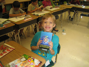 Photo: DeBary Elementary School  third-grader Bryan Scudder, happy to receive a new dictionary from  members of the Rotary Club of DeBary-Deltona