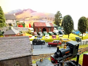 Photo: 013 A view across the village green at Dragons Lair, where there is a classic car rally in full flow, providing a colourful and attractive supplement to the delightful summer scene of the layout .