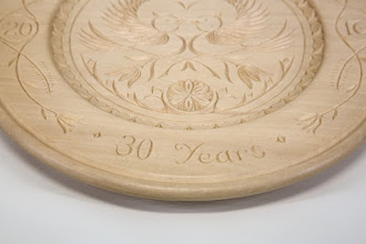 "Photo: Margaret Follas 10"" x 1"" carved plate [basswood]"