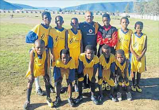 Kaya Baartman from Fort Beafort with one of the soccer teams that took part in this year's Easter Soccer Tournament Picture: SUPPLIED