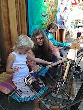 Photo: children take quickly to weaving on the saori piccolo looms