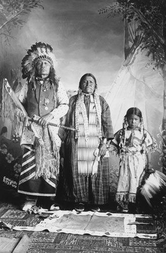 Photo: Chase The Bear (aka Chasing Bear, aka Paul Brave) with his wife and their daughter Susan - Hunkpapa/Sihasapa - 1911