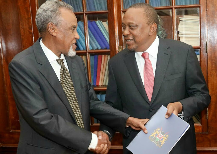 President Uhuru Kenyatta receives the BBI report from task force chairman Senator Yusuf Haji on November 27.