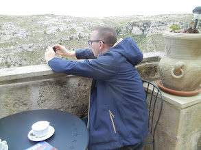 Photo: The hotel we stayed at had a wonderful the breakfast area with a big view. Matera is all about the view, as you will see in the upcoming photos. Chris took out his camera immediately on seeing that big view, so did I. It's so beautiful. We couldn't stop taking pictures. Apologies in advance for so many pictures of the same place but it is just gorgeous.