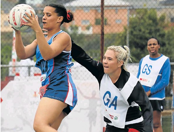 West Coast's Berita Maleas controls possession as she is challenged by Ethekwini's Sue-Ann Botha in the SPAR national netball championships at Young Park on Friday