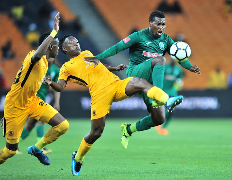 Teenage Hadebe and Daniel Cardoso of Kaizer Chiefs challenged by Mhlengi Cele of AmaZulu during the Absa Premiership 2017/18 match between Kaizer Chiefs and AmaZulu at FNB Stadium, Johannesburg on 17 March 2018.