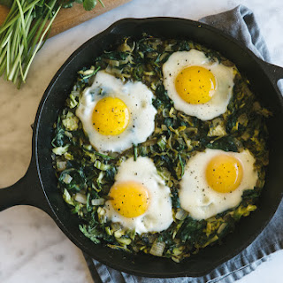 Green Shakshuka with Shaved Brussel Sprouts and Spinach.