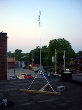 Photo: Ubiquiti Nanostation M5 and Engenius EOC-1650 mounted to top of a 15foot tall homemade roof tripod, for completely non-penetrating roof mount.