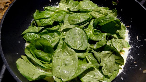 Add the spinach leaves.