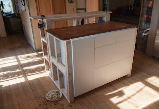 Photo: Island Frame -- Front. Those ugly white drawer fronts will all be replaced with wood the color of the table top sitting on the island.