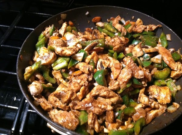 ADD CHICKEN STIR FREQUENTLY UNTIL CHICKEN IS ALMOST COOKED...THEN ADD ONIONS, GREEN PEPPERS AND...