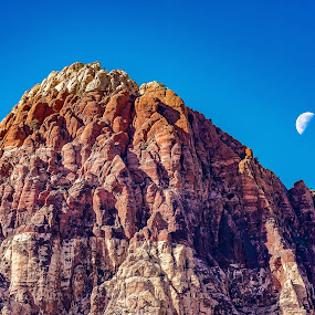 Mountain Peak in Nevada by Fred Bartholomew - Landscapes Mountains & Hills ( climbing, moon, red, sky, mountain, nature, blue, peak, nevada, cliff, canyon, rock, day )